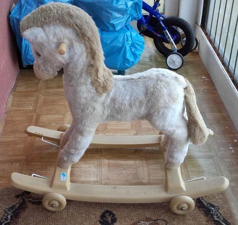 Koń na biegunach z kółkami Rolly Toys