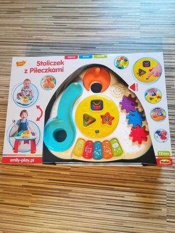 Stolik z piłeczkami edukacyjny interaktywny smily-play 12m+ NOWY