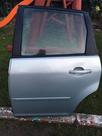 Drzwi tylne tył Ford Focus C-Max 2004r.Sprzęgło Dwumasa Boczki drzwi