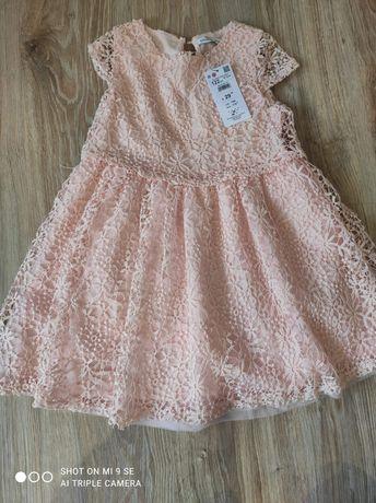 Sukienka koronkowa nowa Reserved w rozmiarze 122