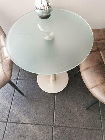 Mesa de vidro com pé em Inox.
