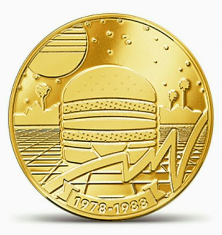 MacCoin. Одна из пяти колекционных монет. 50 лет БигМак. Монета.