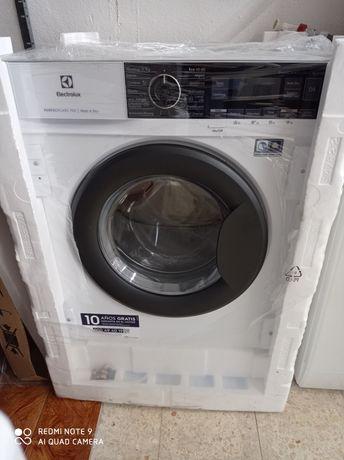 Máquinas de de lavar e secar nova de encastre.Entrego em casa