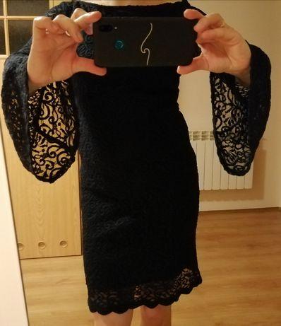 Elegancka sukienka z grubej koronki