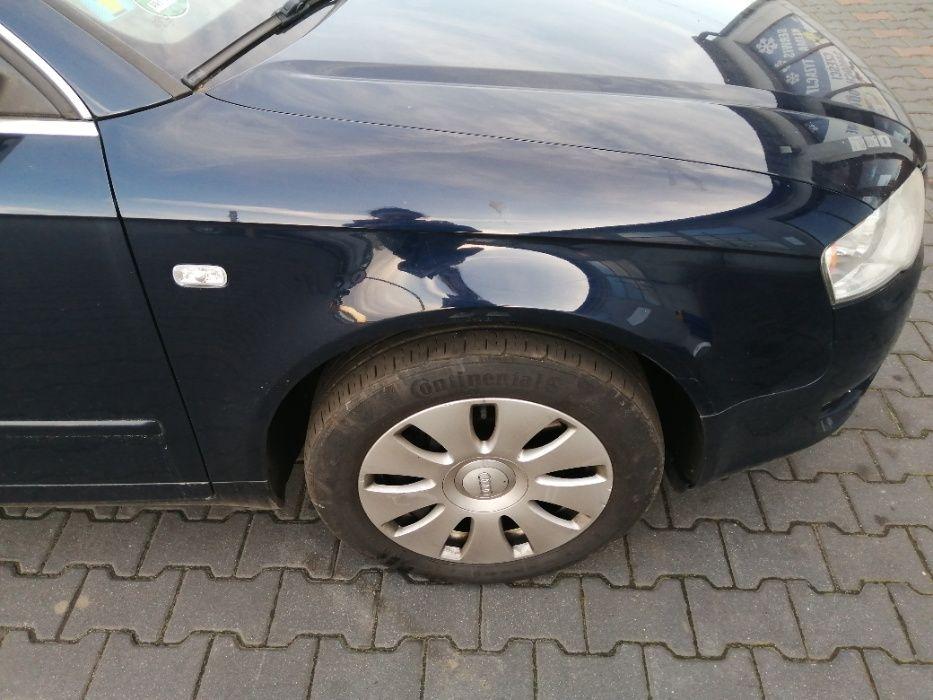 Błotnik prawy przedni Audi A4 B7 lakier LZ5J Świba - image 1