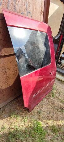 Боковая дверь Кадди 2005 года