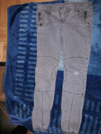 Spodnie Divided by H&M rozm. 28