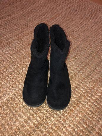 Botas de pelo pretas