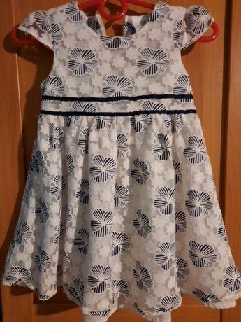 Sukienka dziewczęca w granatowe kwiatki rozmiar 86