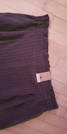 Nowe spodnie w paski piękne TU z falbanką