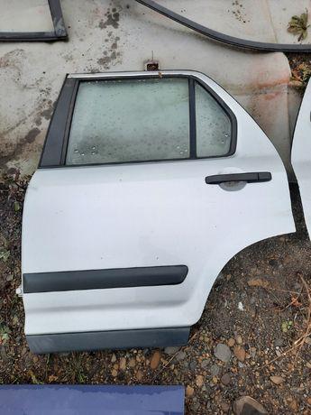 Drzwi lewe tylnie Honda CRV II 02-04r. NH623M
