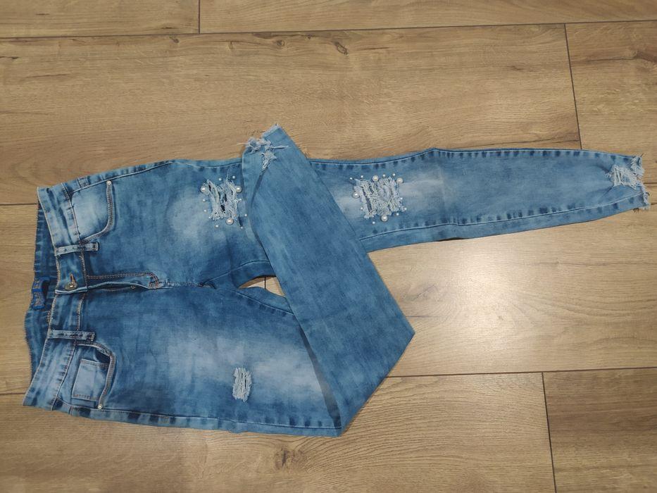 Spodnie z dziurami Dobroń - image 1