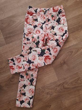 Spodnie w kwiaty H&M 122