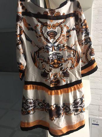 Платье летнее шелк , шорты короткие темные , в хорошем состоянии .