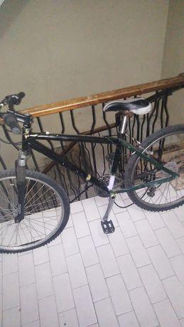 Bicicleta verde ( com amordecedor a frente )