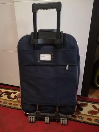 Ручка на калесиках для чемодана