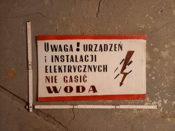 """Tablica PRL """"Uwaga! Urządzeń i instalacji elektrycznych nie gasić wodą"""
