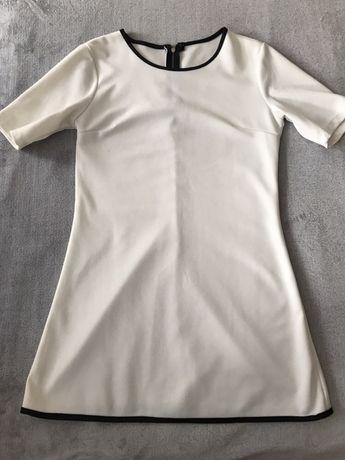 Elegancka biała sukieneczka
