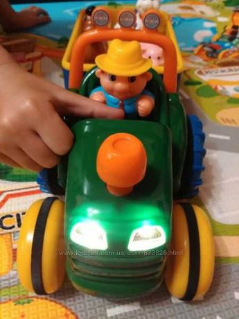 Игрушка на колесах Kiddieland - Трактор с трейлером на укр. языке б/у