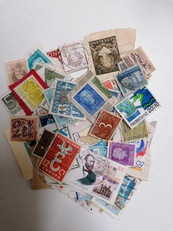 50 selos diferentes antigos da Holanda, de 1910 a 2000s