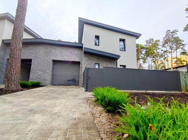 Новый дом с гаражом в центре Бучи