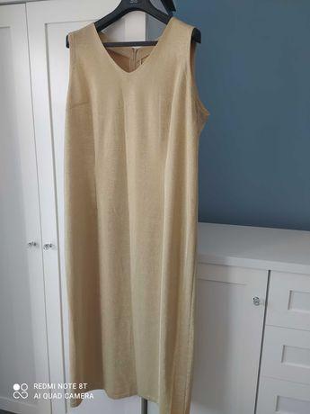 Piękna złota długa suknia