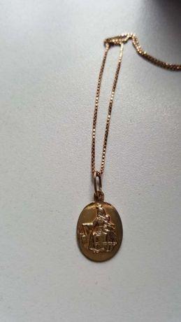 Złoty medalik dwustronny 585.Waga 2.26.