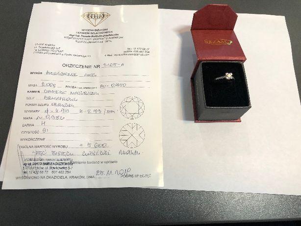 Złoty pierścionek 18k z diamentem roz. 15