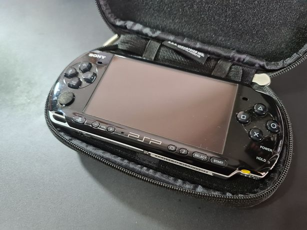 Sony PSP Slim + 3 jogos + bolsa + 2 cartões de memória