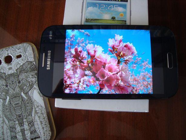Galaxy Grand GT-I9082 на 2 симкарты.