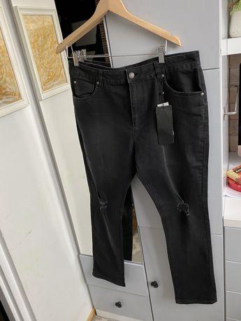 Czarne spodnie jeans przetarcia w40 xxl