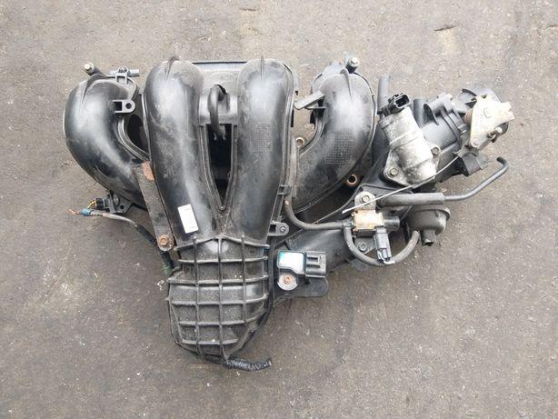 Kolektor ssący z przepustnicą Kpl.Mazda 1.8 16V benzyna