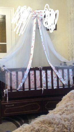 Дитяча кроватка-ліжко