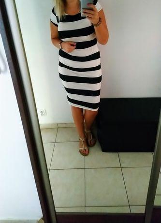 Piękna dopasowana sukienka XL