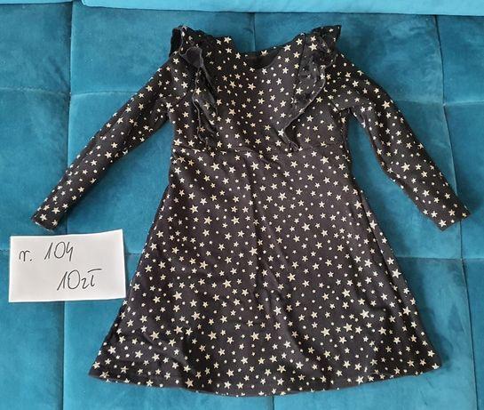 Czarna sukienka w złote gwiazdki rozmiar 104