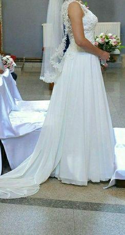 Piękna suknia ślubna .