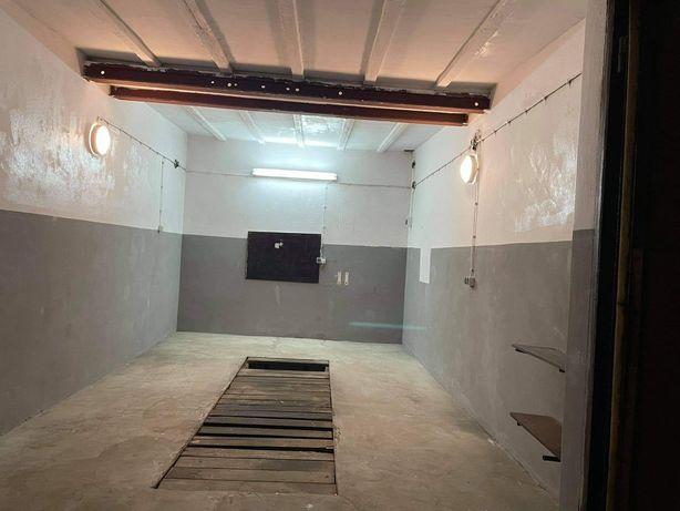 Duży garaż murowany z.instalacja elektryczna i kanałem