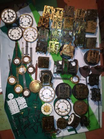 Часы настенные, каминные, циферблаты, маятники, ключи, шкалы эмалевые.