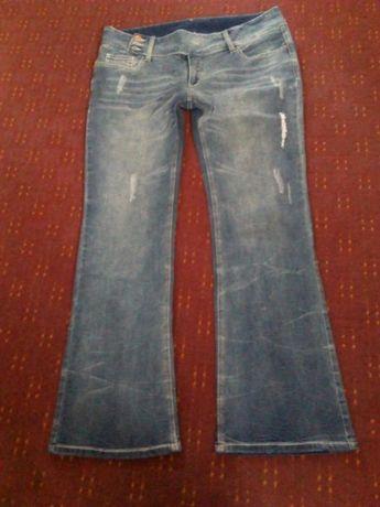 Nowe spodnie jeansowe BONPRIX z przetarciami