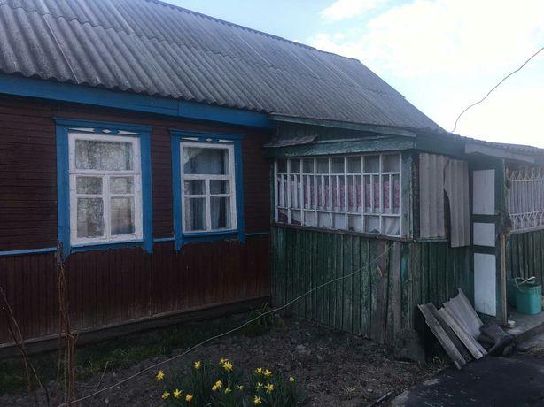 Продам дом в с. Выгов с летней кухней и гаражом 60 соток земли