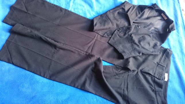 Eleganckie spodnie na kant plus kamizelka 38