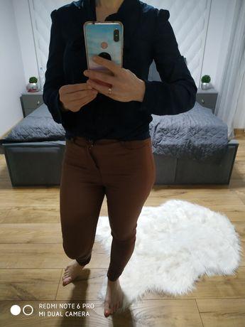 Śliczna bluzka Reserved z wiązana kokardą ,jak nowa