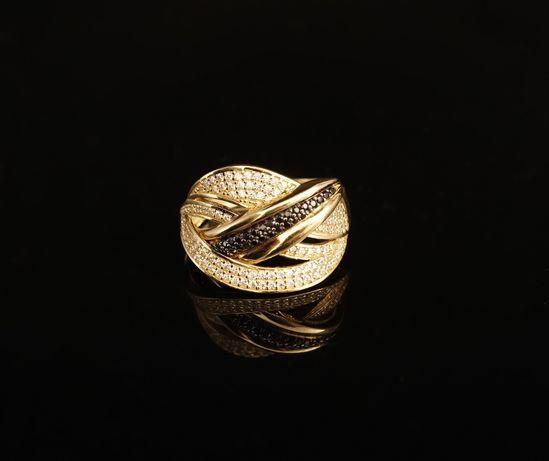 Złoto 585 - złoty pierścionek z cyrkoniami. Rozmiar 19