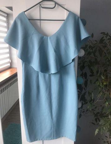 Błękitna sukienka pretty girl 40 L z falbana