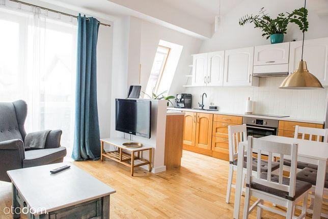 Dwupoziomowe mieszkanie na Warszewie