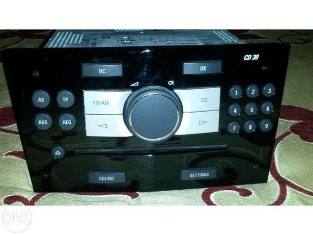 Vendo rádio Opel Astra CD30 (em preto) + BID (com moldura)
