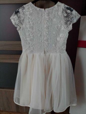 Sprzedam sukienkę 146/152