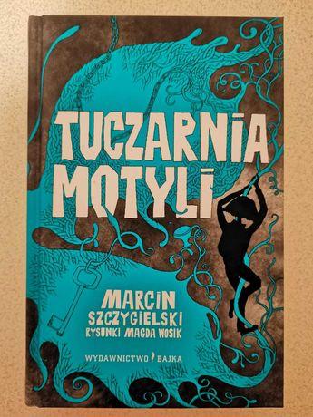 Tuczarnia Motyli, Marcin Szczygielski
