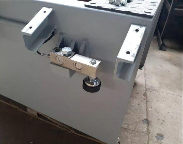 Установка датчиков веса на тормозные стенды.