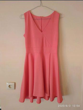 Brzoskwiniowa rozkloszowana sukienka
